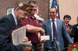 Previous VFW Post 2348 Commander, Mike Mehltretter, with Rocco Moretto and Councilmember Peter Vallone Jr., displaying the $5,000 check presented by Councilmember Peter Vallone Jr. to VFW Post 2348 in honor of Rocco Moretto.