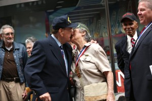 World War II veterans Rocco Moretto, left, and Annette Marge Zwick, right, share a kiss outside the Times Square Walgreens store. The two were part of a group of veterans who gathered to commemorate the 67th anniversary of V-J Day. (Kevin Hagen for The Wall Street Journal)